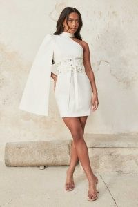 LAVISH ALICE high neck cape mini dress with corset belt in white ~ glamorous one sleeve party dresses ~ womens occasion fashion ~ women's party clothing
