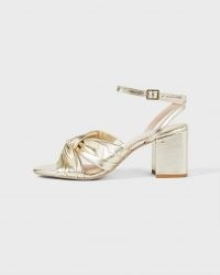 Ted Baker TABBO Metallic Leather Mid Heel Sandal – gold vintage style front twist sandals – ankle strap occasion shoes – luxe block heels