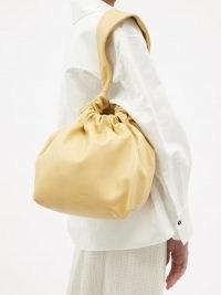 JIL SANDER Drawstring-top medium cream leather clutch / womens slouchy bags