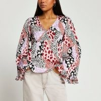 RIVER ISLAND Pink long flute sleeve top / flared sleeve tops