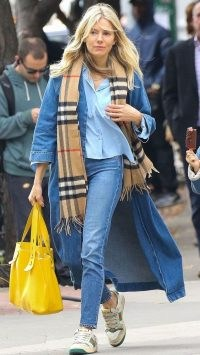 Sienna Miller in a denim maxi coat and a pair of skinnies, proving a double denim outfit isn't beyond the bounds of possiblity when you want to look cool and stylish | celebrity street style
