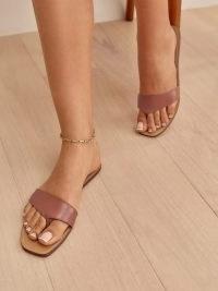 Reformation Serina Asymmetrical Thong Sandal in Acorn – women's chic thonged summer flats