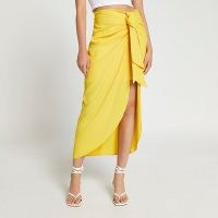 River Island Yellow satin front tie midaxi skirt | womens ruched skirts | women's on trend fashion