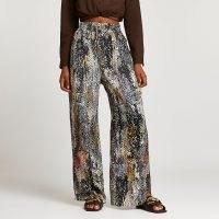 RIVER ISLAND Black snake print wide leg trousers / womens animal print pants / reptile prints