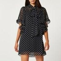 RIVER ISLAND Black spot print tie front swing dress / semi sheer polka dot frill trim dresses