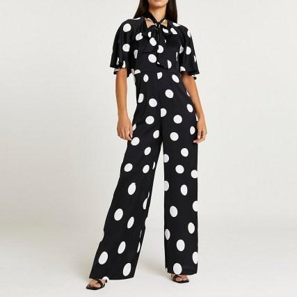 RIVER ISLAND Black spot print tie neck jumpsuit / polka dot jumpsuits - flipped