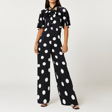 RIVER ISLAND Black spot print tie neck jumpsuit / polka dot jumpsuits