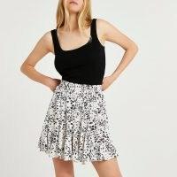 RIVER ISLAND Cream leopard print mini skirt / womens animal print skirts