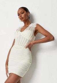 Missguided cream mesh tie shoulder corset mini dress | semi sheer luxe style going out dresses | ruched evening fashion