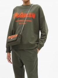 ALEXANDER MCQUEEN Logo-print cotton-jersey sweatshirt in khaki-green ~ womens slouchy fit graffiti logo print sweatshirts ~ women's designer sweat tops