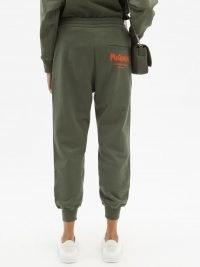 ALEXANDER MCQUEEN Khaki-green logo-print cotton-jersey track pants ~ womens graffiti logo cuffed hem joggers ~ women's designer cuff leg jogging bottoms ~ casual fashion