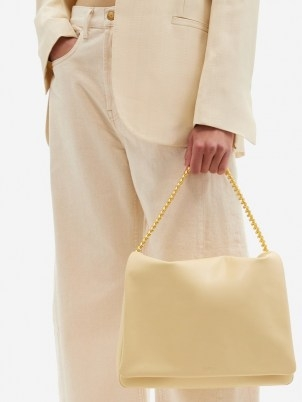 NEOUS Orbit chain-strap cream leather shoulder bag | luxe flap closured handbags | chic bags - flipped