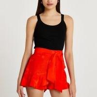 RIVER ISLAND Orange jacquard frill tie waist shorts / bright ruffle trim shorts