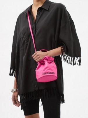BALENCIAGA Wheel XS canvas bucket bag ~ womens small logo print crossbody bags ~ women's designer accessories - flipped