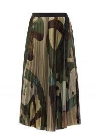SACAI X Kaws camouflage-print pleated crepe skirt | khaki green camo print midi skirts
