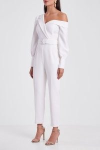 LAVISH ALICE tailored off shoulder jumpsuit in white – chic one shoulder belted waist jumpsuits – going out evening fashion