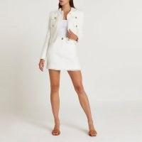 River Island White boucle mini skirt | texured fabric frayed hem skirts