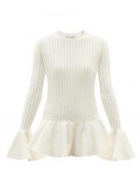 JW ANDERSON Fluted ribbed-knit wool-blend sweater | flared hem sweaters | womens crew neck peplum jumpers | women's feminine knitwear