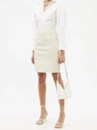 GIVENCHY 4G-embossed cutout cream leather pencil skirt | luxe cut-out back detail skirts