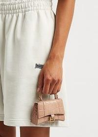 BALENCIAGA Hourglass mini blush leather cross-body bag / small cute croc effect handbags / luxe petite top handle crocodile embossed bags / light pink crossbody