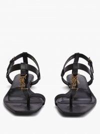 SAINT LAURENT Cassandra YSL-plaque black leather sandals | chic designer flats