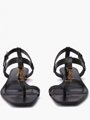 SAINT LAURENT Cassandra YSL-plaque black leather sandals   chic designer flats - flipped