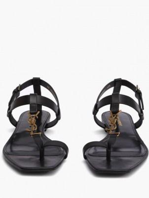 SAINT LAURENT Cassandra YSL-plaque black leather sandals   chic designer flats