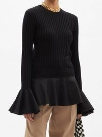 JW ANDERSON Fluted ribbed-knit wool-blend sweater in black | peplum hem sweaters | womens chic knitwear | feminine jumpers