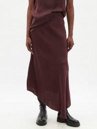RAEY Fluid dip-hem midi skirt in burgundy ~ dip hem skirts ~ womens minimalist fashion