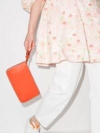 Chloé Darryl orange leather clutch bag | women's bright designer bags | womens minimalist accessories