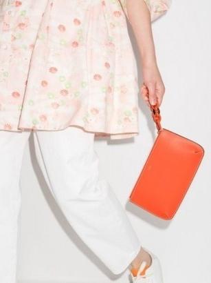 Chloé Darryl orange leather clutch bag | women's bright designer bags | womens minimalist accessories - flipped
