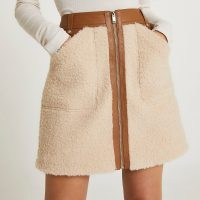 River Island Cream faux leather and borg zip mini skirt | textured faux shearling slip pocket detail skirts | fluffy fashion