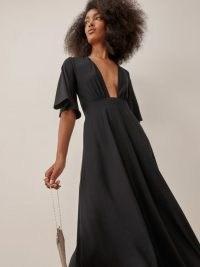 Reformation Ernest Dress in Black | deep plunge front LBD | plunging neckline fashion | feminine flared sleeves