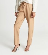 REISS EVE PULL ON FORMAL JOGGERS CAMEL ~ womens neutral light brown jogging bottoms ~ sweatpant waistband with zip fly