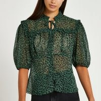River Island Green animal print tie frill top – sheer high neck blouses
