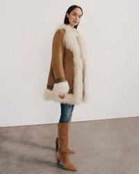 NILI LOTAN HARRISON MONGOLIAN FUR SHEARLING COAT   70s inspired shaggy fur trimmed coats   womens retro winter outerwear
