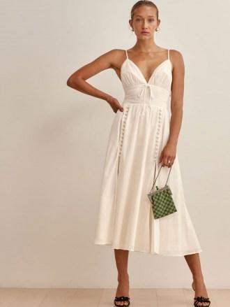 Reformation Jolene Dress in Cream | skinny strap high slit hem dresses | beautiful feminine fashion | organic cotton clothing - flipped