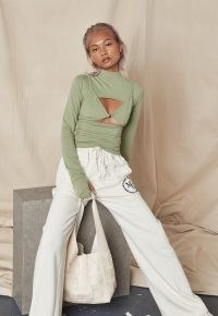 MISSGUIDED khaki cut out bralet overlay top – green long sleeve high neck tops