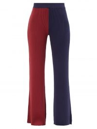 STAUD Faama colour-block ribbed-knit flared trousers / chic knitted colourblock pants / burgundy and navy blocked knitwear / red and blue