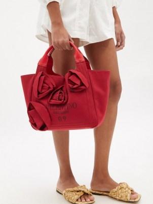 VALENTINO GARAVANI Atelier red floral-appliqué canvas tote bag   women's designer shopper bags   chic shoppers   womens top handle grab bags