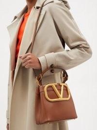 VALENTINO GARAVANI Supervee tan leather bucket bag | women's designer logo shoulder bags | womens brown top handle handbags | chic accessories