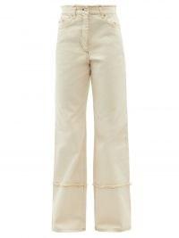 JW ANDERSON Logo-embroidered raw-edge wide-leg jeans in cream ~ women's designer denim ~ casual fashion