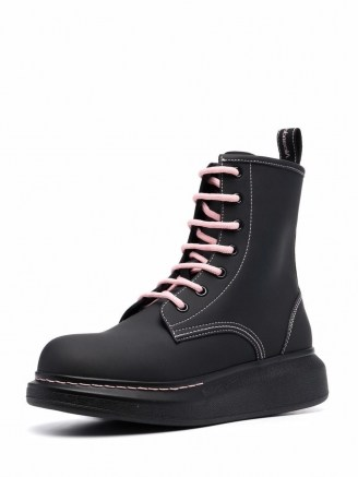 Alexander McQueen Women's chunky sole combat boots in Matte Black / Ice Pink - flipped