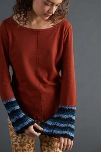Pilcro Crochet-Cuffed Top in Cedar ~ brown curved hem tops with knitted cuffs