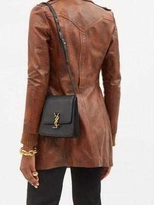 SAINT LAURENT Kaia YSL-plaque black leather cross-body bag | chic designer crossbody bags - flipped
