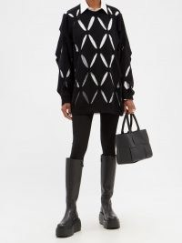 VALENTINO Optical Valentino cutout wool sweater in black – cut out sweaters – womens oversized designer jumpers – women's on trend knitwear