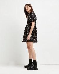 River Island Black polka dot mini dress | cute puff sleeve ruffle hem dresses | spot print fashion