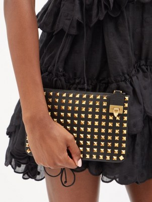 VALENTINO GARAVANI Rockstud flip-clasp black leather pouch   small stud embellished pouches   studded clutch bags - flipped