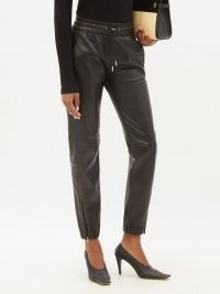 SAINT LAURENT Zip-cuff black leather trousers ~ womens sportswear inspired trousers ~ women's luxury style joggers ~ sports luxe jogger pants