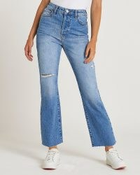 River Island Blue ripped high waisted flared jeans